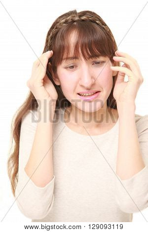 portrait of young woman suffers from headache