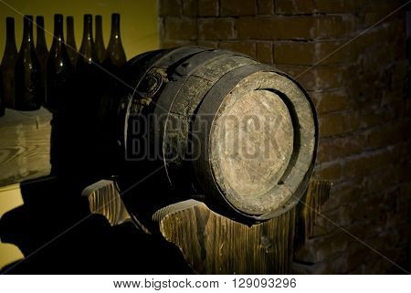 The old oak wine barrels stacked in the cellar