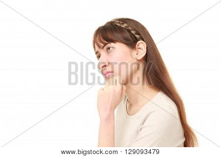 portrait of young woman worries about something