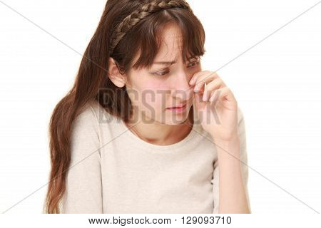 portrait of young woman cries on white background