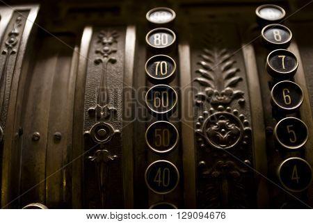 Closeup view of buttons on a vintage cash register.