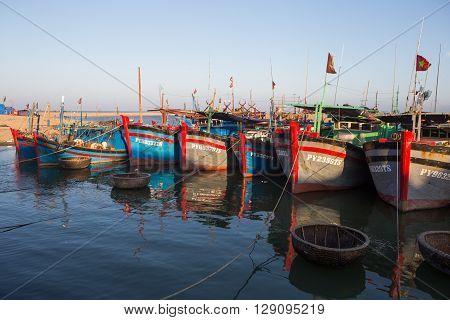 Phu Yen, Vietnam - Apr 22, 2016: Vietnamese wooden fishing boat anchoring at a harbor on a shore in Tuy Hoa beach city, central Vietnam.