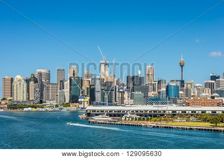 Sydney Australia - November 11 2014: Sydney's business district view from the Johnstons Bay Sydney New South Wales Australia. Barangaroo is a new part of the Sydney CBD located on the western harbour foreshore. Doltone House in the foreground.