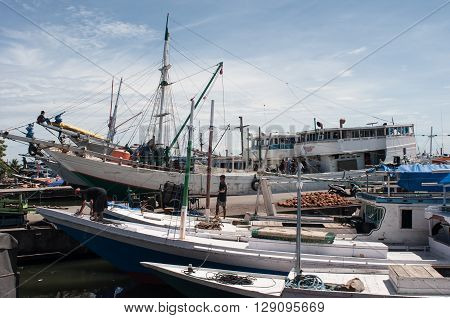 MAKASSAR, INDONESIA - APRIL 30, 2016: Wooden ships anchored at Paotere Harbor in Makassar Indonesia. Paotere is an old traditional harbor in Eastern Indonesia.