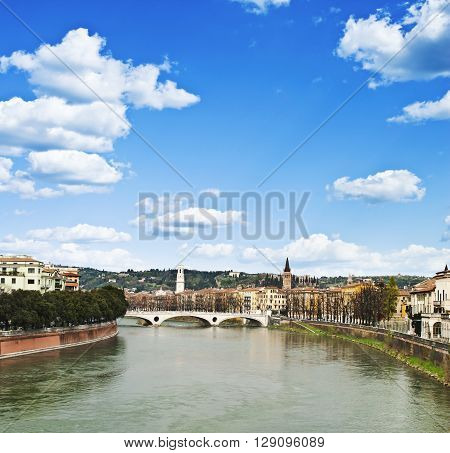 Adige River on a background of blue sky in Verona, Italy