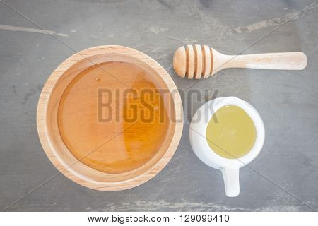 Golden honey cup and lime juice on top view, stock photo