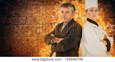 Portrait of chef and businessman back to back against image of a wall