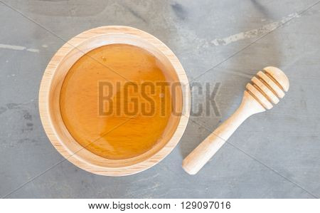 Golden honey cup and dipper on top view, stock photo