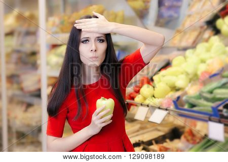 Shocked Woman with Green Pepper Shopping in a Supermarket