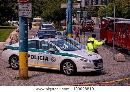 Bratislava, Slovakia - May 29: Police car with policeman on the street on May 29, 2015 in Bratislava, in Slovakia