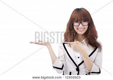 Beautiful young asian business woman presenting your product