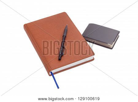 Brown business diary with blue page-marker ribbon black ballpoint pen and wallet with business cards on a light background