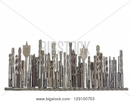Several old drills and bits different sizes designs for different purposes and with different shapes of shank on a light background
