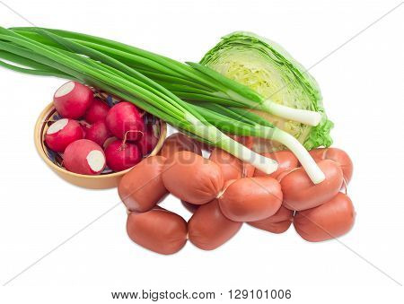 Bunch of uncooked short thick wieners with natural casings tied with twine several stalks of green onion bowl with red radish and young white cabbage on a light background