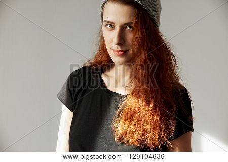Picture Of Young Woman Looking At The Camera With Concentrated Expression. Student Girl With Long Re