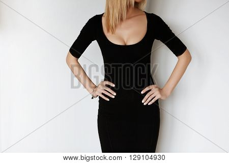 Young Attractive Woman In Black Low Dress Getting Ready For First Date. Cropped Portrait Of Sensual