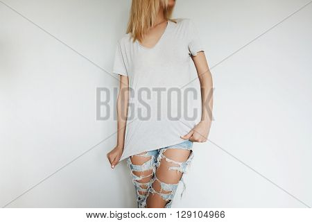 Slim Young Woman With Blonde Hair Wearing Gray Oversized T-shirt After Having Morning Outdoor Physic