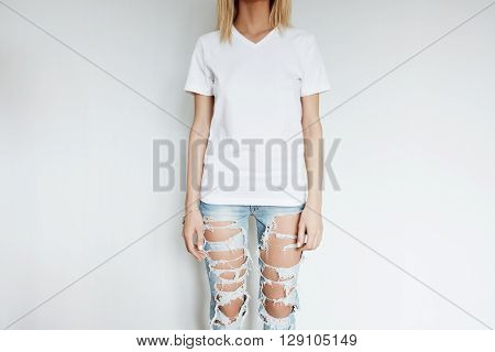 Cropped View Of Blonde Slim Girl Wearing Blank T-shirt With Copy Space For Your Content. Young Woman