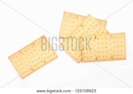 Biscuits or crackers on white background -
