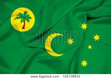Waving Flag of Cocos Islands, with beautiful satin background.