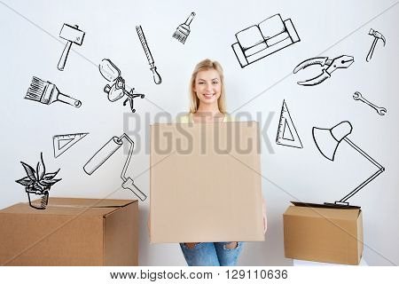 moving, repair, housing, accommodation and people concept - smiling young woman with cardboard box at home over doodles