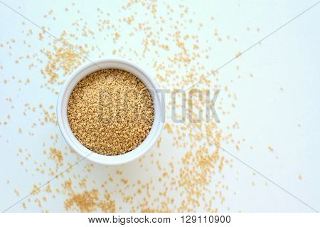 Wholegrain Couscous In The Bowl On The White Background