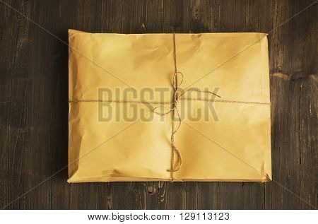 Vintage craft paper envelope tied up with string. Toned image. Toned image