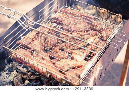 shashlik. preparation of marinated meat over hot coals