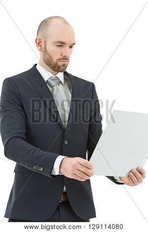 Caucasian business man working on a file at the office. Isolated on white background.