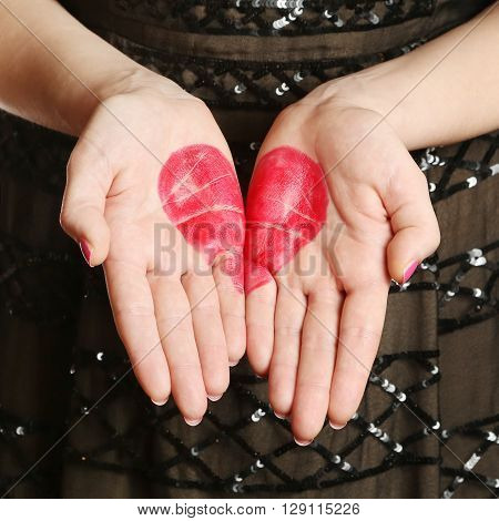 Red heart shape drawn on female palms