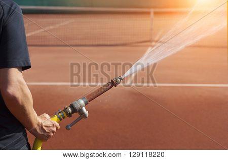 Person for maintenance sprinkler tennis court