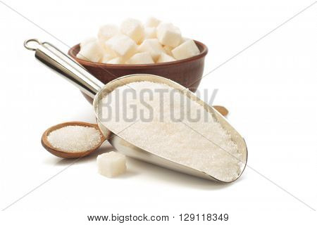 granulated sugar in scoop isolated on white background