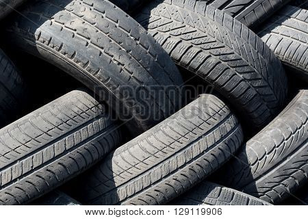 Pile of old used car tires at the dump
