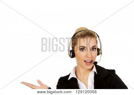Young smile businesswoman presenting something