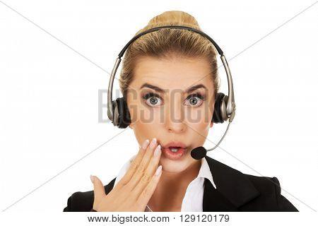 Young beautiful shocked helpline operator