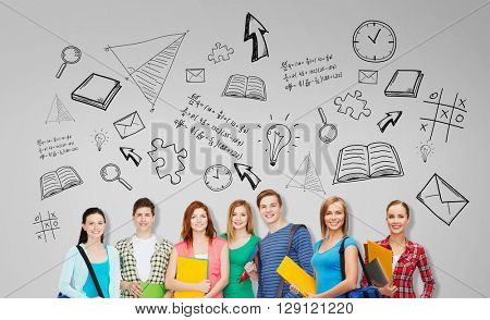 education, school and people concept - group of smiling teenage students with folders and school bags over gray background with doodles