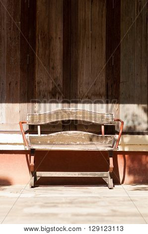 old wooden chair outside in the sunlight