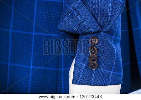 Details Of A Blue Vest On A Mannequin