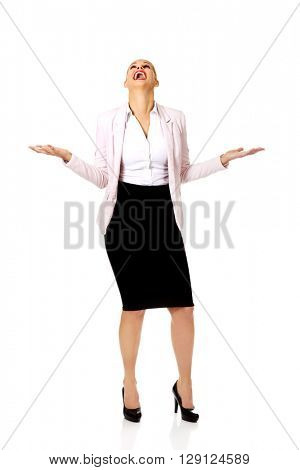 Young businesswoman trying to catch something