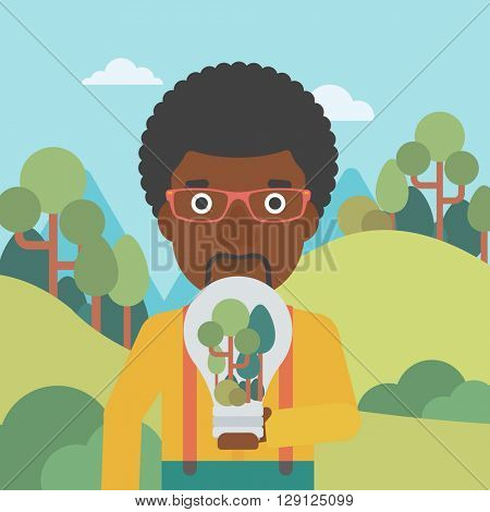 Man with lightbulb and trees inside.