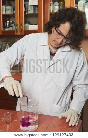 Chemist Mixing Colour Reagents