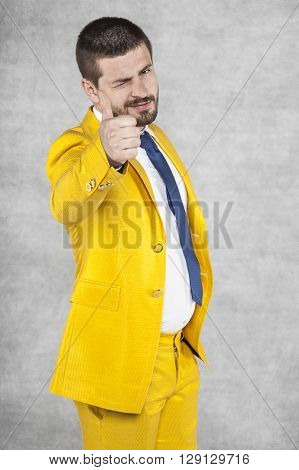 Businessman In Gold Suit Show Thumbs Up