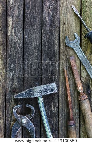 Old carpentry tools on a wooden background. Preparing for carpentry work