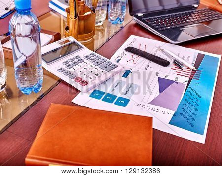 Business interior on table with business diagram in office.