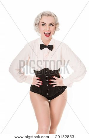Cute Burlesque Dancer Strikes A Pose, Dressed In Bow Tie, Frilled Shirt & Corset, Isolated On White