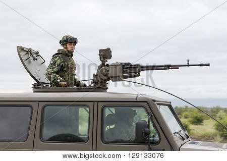 Military Vehicle With Heavy Machine Gun And Soldier