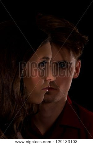 Man is serious looking on a woman.
