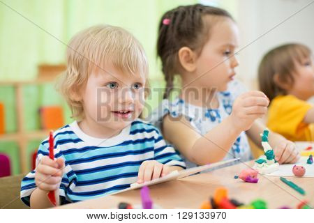 kids making arts and crafts in day care centre together