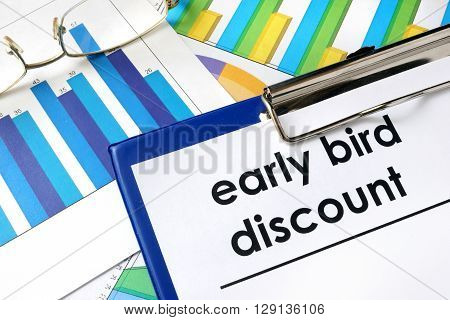Paper with words Early bird discount and charts.