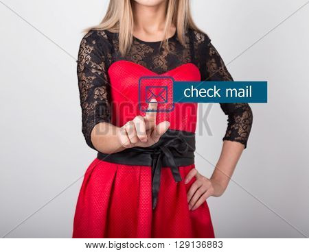 technology, internet and networking concept. beautiful woman in a red dress with lace sleeves. woman presses check mail button on virtual screens.